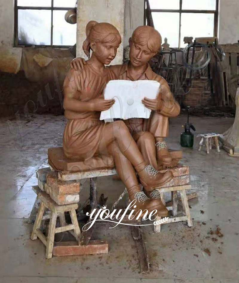 Custom Bronze Boy and Girl Reading Books Garden Statue for Sale Clay Molds